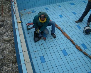 Re-leveling of swimming pool